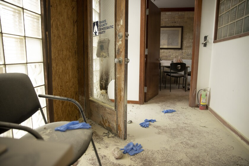 A rock remains on the floor at the Travis County Democratic Party office on East 6th Street in Austin, Texas, on Wednesday, Sept. 29, 2021, after someone threw a rock and an incendiary device into the building. (Jay Janner/Austin American-Statesman via AP)