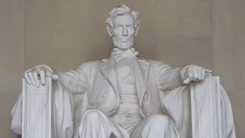 The words of Lincoln's second inaugural address are inscribed on a wall near the statue of the president at the Lincoln Memorial in Washington, D.C.