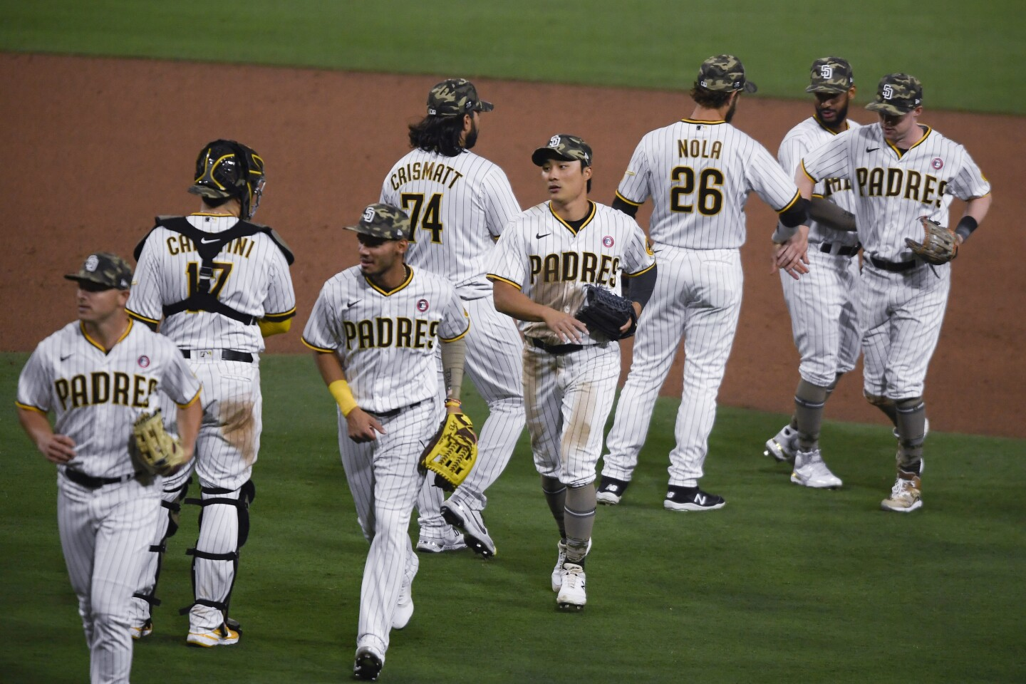 San Diego Padres high-five after the Padres defeated the St. Louis Cardinals 13-3 in a baseball game Saturday, May 15, 2021, in San Diego. (AP Photo/Denis Poroy)