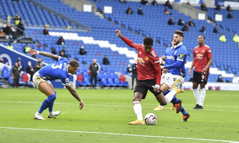 Manchester United's Mason Greenwood shoots and scores his sides second goal of the game during the English Premier League soccer match between Brighton Hove Albion and Manchester United in Brighton, England, Saturday, Sept. 26, 2020. (Glyn Kirk/Pool via AP)