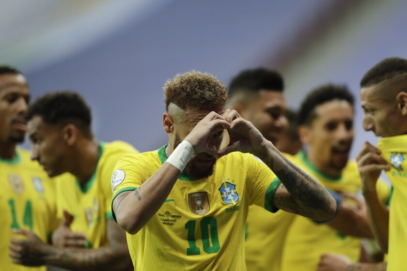 Brazil's Neymar celebrates scoring his side's second goal against Venezuela on a penalty kick during a Copa America soccer match at the National Stadium in Brasilia, Brazil, Sunday, June 13, 2021. (AP Photo/Eraldo Peres)