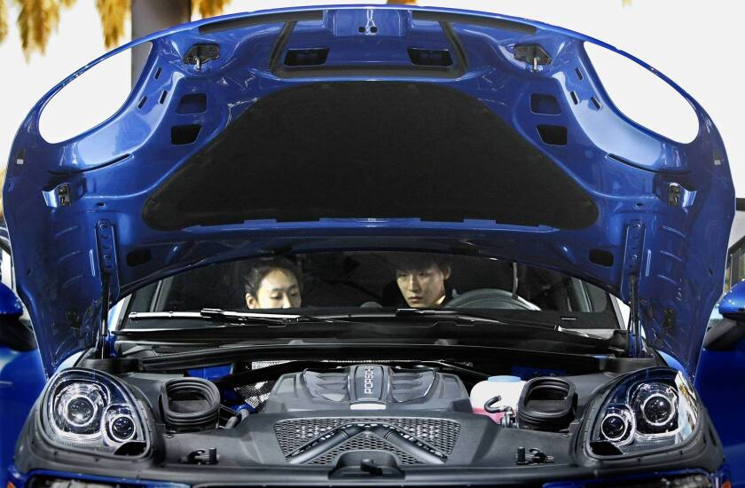 About half the visitors to the L.A. Auto Show are looking to buy a car soon, said Brendan Flynn, senior director of marketing and communications for the event. Above a couple examine the interior of a 2014 Porsche at the show.