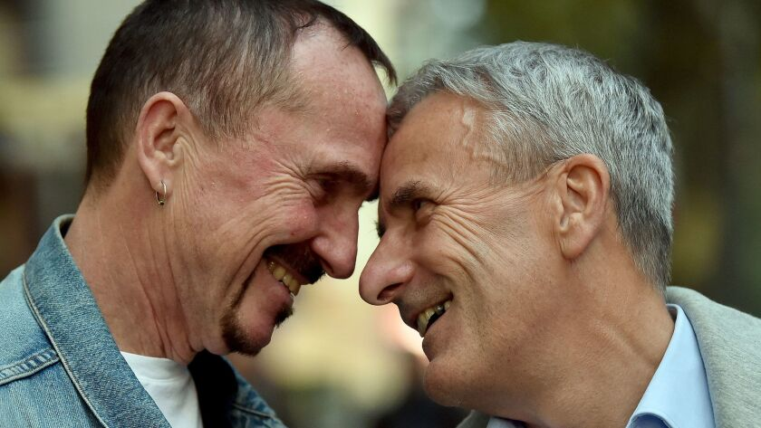 Karl Kreile, left, and Bodo Mende in Berlin on Sept. 27, 2017. Almost 40 years after their first kiss, Karl and Bodo are getting hitched.