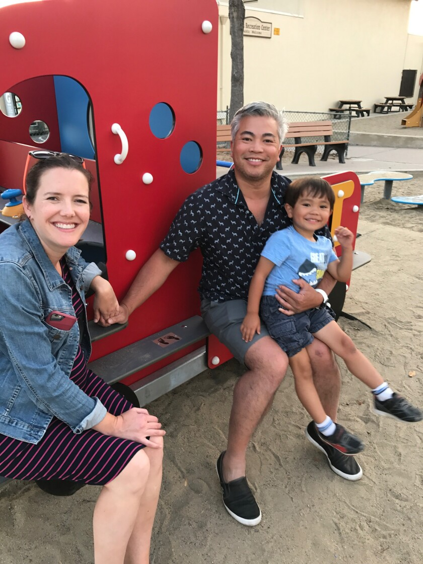 Katherine and Chris Pham with their son Carlton in July 2017, after Baby Jane's fire truck was installed at La Jolla Rec Center.