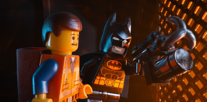 """Emmet (voiced by Chris Pine) and Batman (voiced by Will Arnett) are uneasily on the same side in """"The Lego Movie."""""""