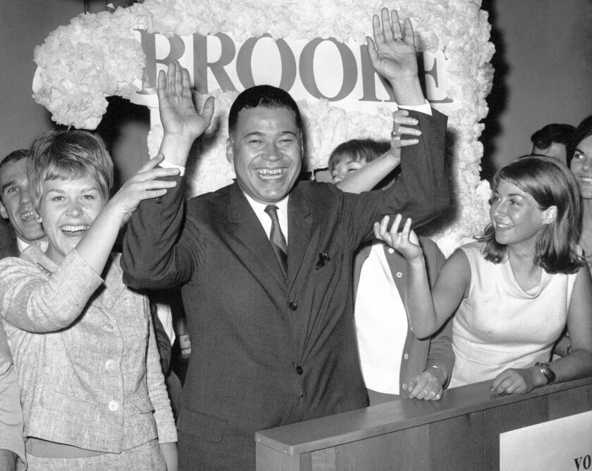 A jubilant Edward Brooke celebrates winning the Republican nomination for U.S. Senate in September 1966. In the Senate, Brooke supported housing and other anti-poverty programs.