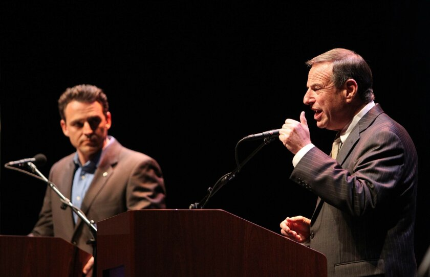 Mayoral candidates Nathan Fletcher (left) and Bob Filner debate at the Balboa Theatre Wednesday night.
