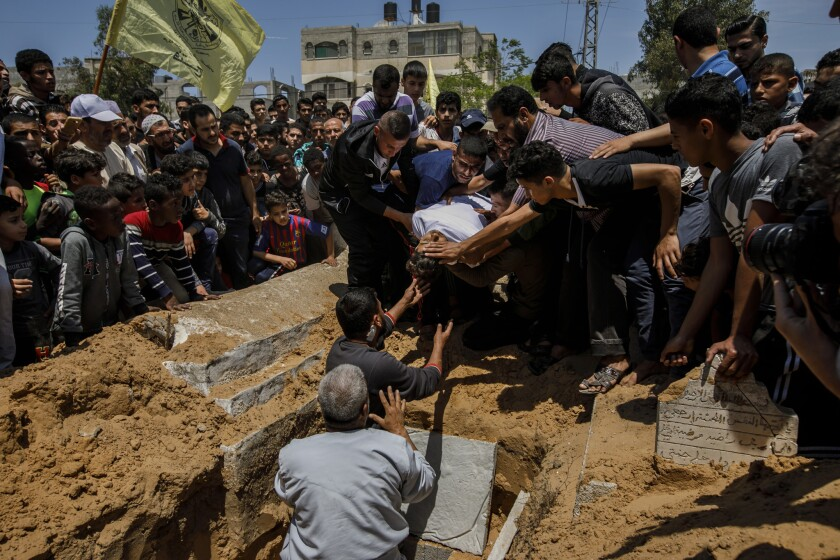 A crowd gathers for the burial of Jamal Afaneh, 15, who was shot in Friday's protest at the Gaza-Israel border.
