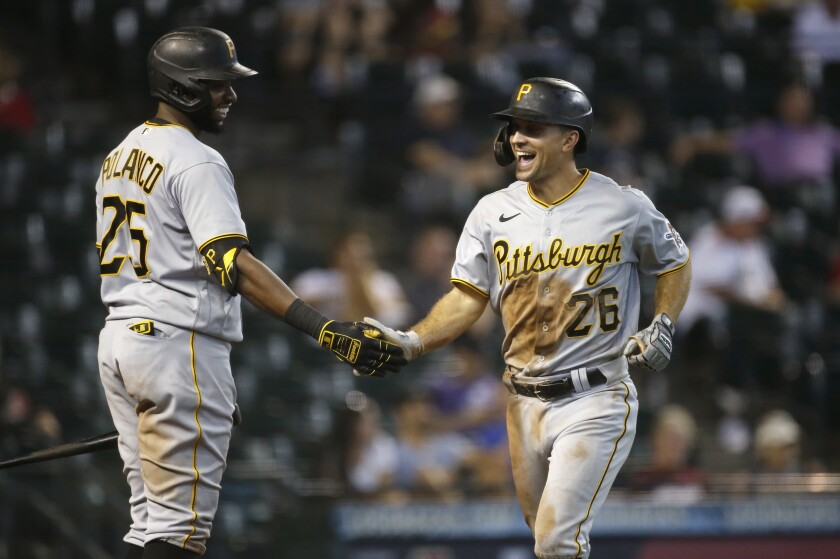 Adam Frazier (right) is heading from the Pirates to the Padres after Sunday trade. At left is Pittsburgh's Gregory Polanco.