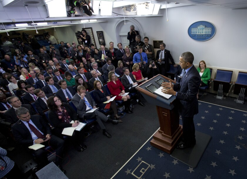 President Obama speaks during a news conference in the White House briefing room on Dec. 18.