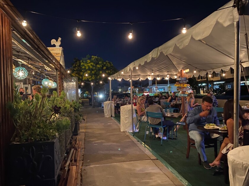 """In July, Beaumont's restaurant in Bird Rock built a """"parklet"""" for outdoor seating on its adjacent parking spaces."""