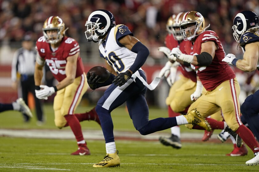 Rams cornerback Jalen Ramsey runs back an interception against the San Francisco 49ers in 2019.