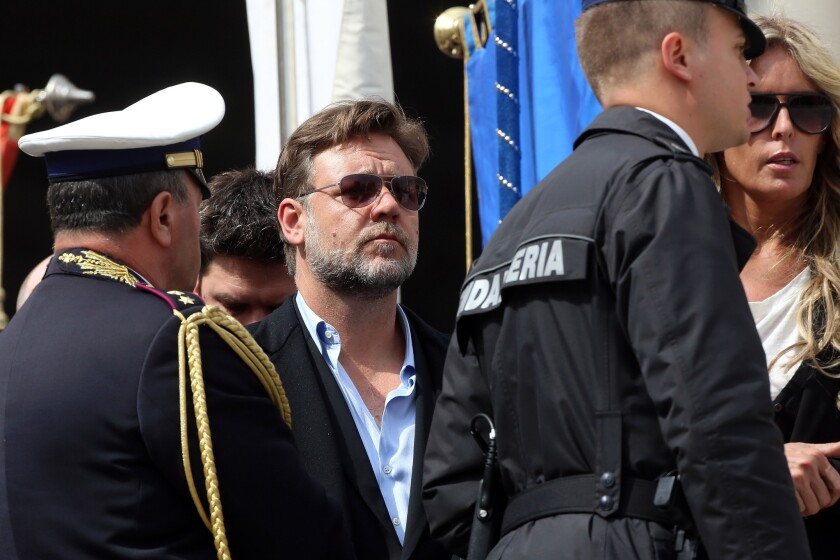Russell Crowe, center, attends Pope Francis' weekly audience in St. Peter's Square.