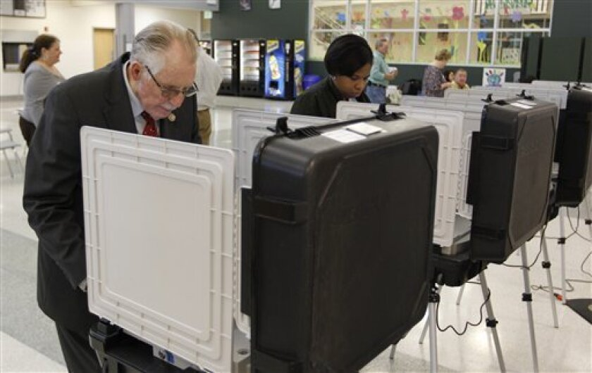 U.S. Rep. Roscoe Bartlett, R-Md., left, votes at a polling place during a primary election in Ballenger Creek, Md., Tuesday, April 3, 2012. (AP Photo/Luis M. Alvarez)