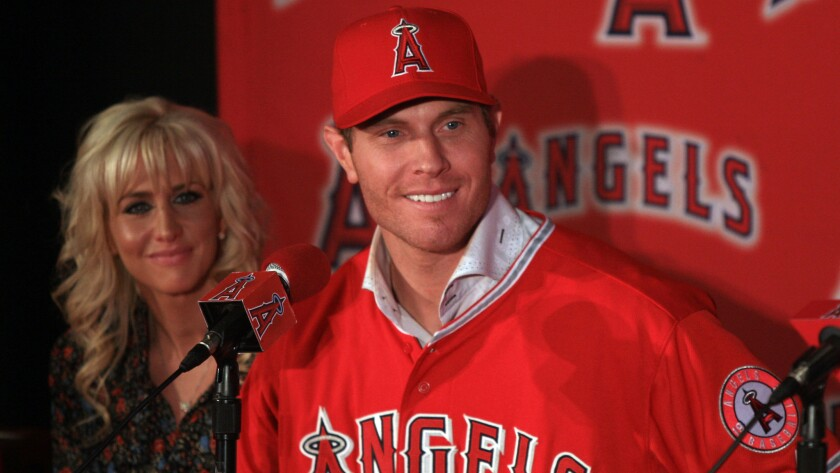Angels outfielder Josh Hamilton smiles while sitting next to his wife, Katie, during his introductory Angels news conference on Dec. 15, 2012.
