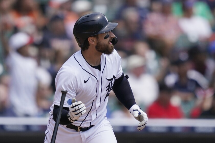 Detroit Tigers' Eric Haase watches his three-run home run to left field during the first inning of a baseball game against the Texas Rangers, Thursday, July 22, 2021, in Detroit. (AP Photo/Carlos Osorio)