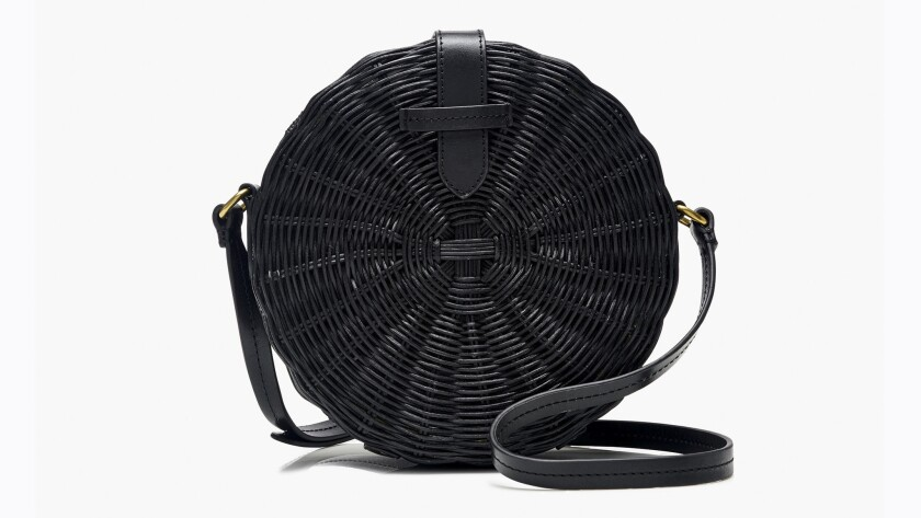 The Circle Straw Crossbody Bag is the ideal, easy-to-carry bag that fits everything you need for a s