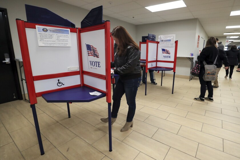 Nikki Foster, democratic candidate for Ohio's first congressional district, votes early at the Warren County Board of Elections, Saturday, March 14, 2020, in Lebanon, Ohio. (AP Photo/Aaron Doster)