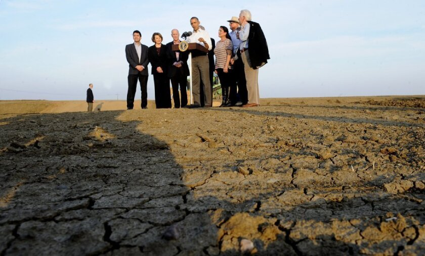 President  Obama tours drought-ravaged farms in  California.