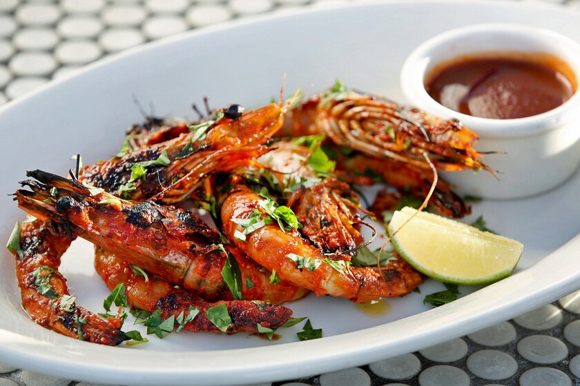 SANTA MONICA, CA., SEPTEMBER 15, 2016 -- Vietnamese Sunbathing Prawns with Fresno chiles, garlic, and Vietnamese hot sauce. Cassia is a casually cool spot for upscale French-Asian fare & seafood served indoors or on the cozy patio, located in Santa Monica. (kirk McKoy / Los Angeles Times)