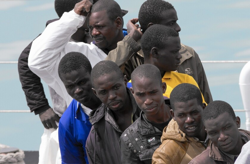 Migrants at Catania harbor in Sicily wait to get off an Italian coast guard ship on April 24, 2015.