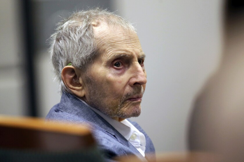 FILE - In this March 10, 2020, file photo, real estate heir Robert Durst looks over during his murder trial in Los Angeles. At a hearing Friday, July 17, 2020, on the resumption of the murder trial of Durst, a Los Angeles judge said it won't resume in late July as planned, and may stay on hold until April. (AP Photo/Alex Gallardo, Pool, File)