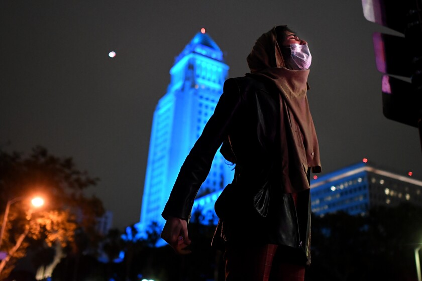 A protester yells near 2nd and Spring streets in downtown Los Angeles on Friday.