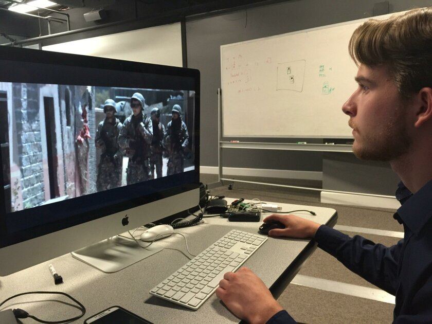 """J.J. Schindler, a student at Escondido's John Paul the Great Catholic University, watches a clip from his film """"Anna"""" in an editing bay."""