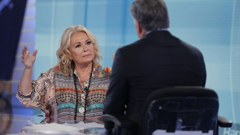 Roseanne Barr talks with Fox News talk show host Sean Hannity while being interviewed during a tapin