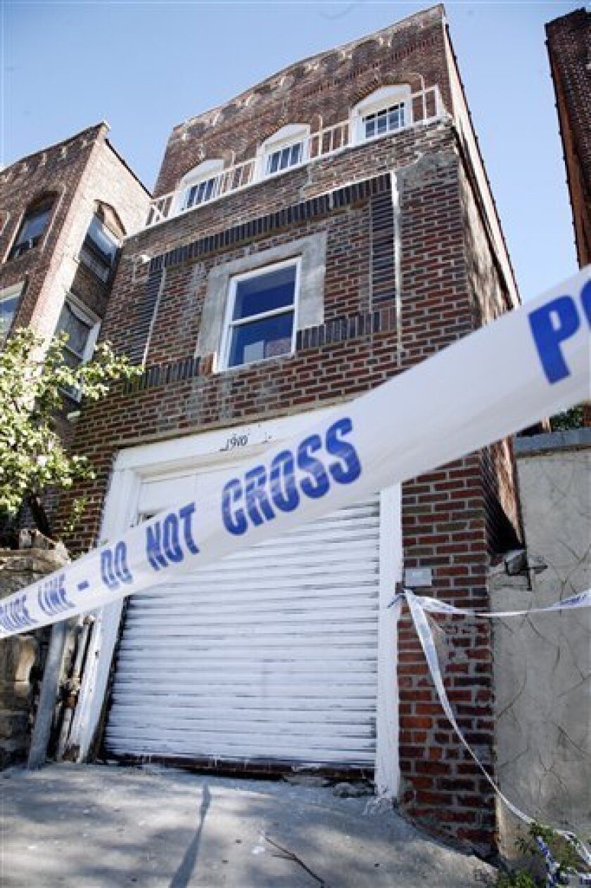 The abandoned home that served as a clubhouse, and allegedly a torture chamber, for a street gang accused of trapping and brutalizing three gay men is seen, Saturday, Oct. 9, 2010 in the Bronx borough of New York. (AP Photo/David Karp)
