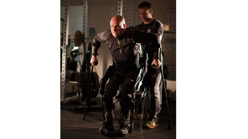 Mark Pollock practices walking with trainer Simon O'Donnell.