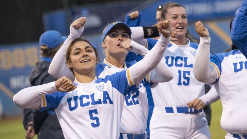 UCLA players celebrate after winning the regional against Missouri at Easton Stadium on Sunday. On Friday, the Bruins beat James Madison in Game 1 of their super regional.