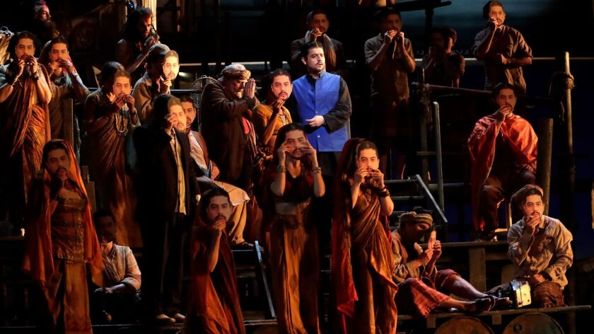 """Alfredo Daza as Zurga (center, blue vest) in the new production of Bizet's """"The Pearl Fishers"""" by Los Angeles Opera."""
