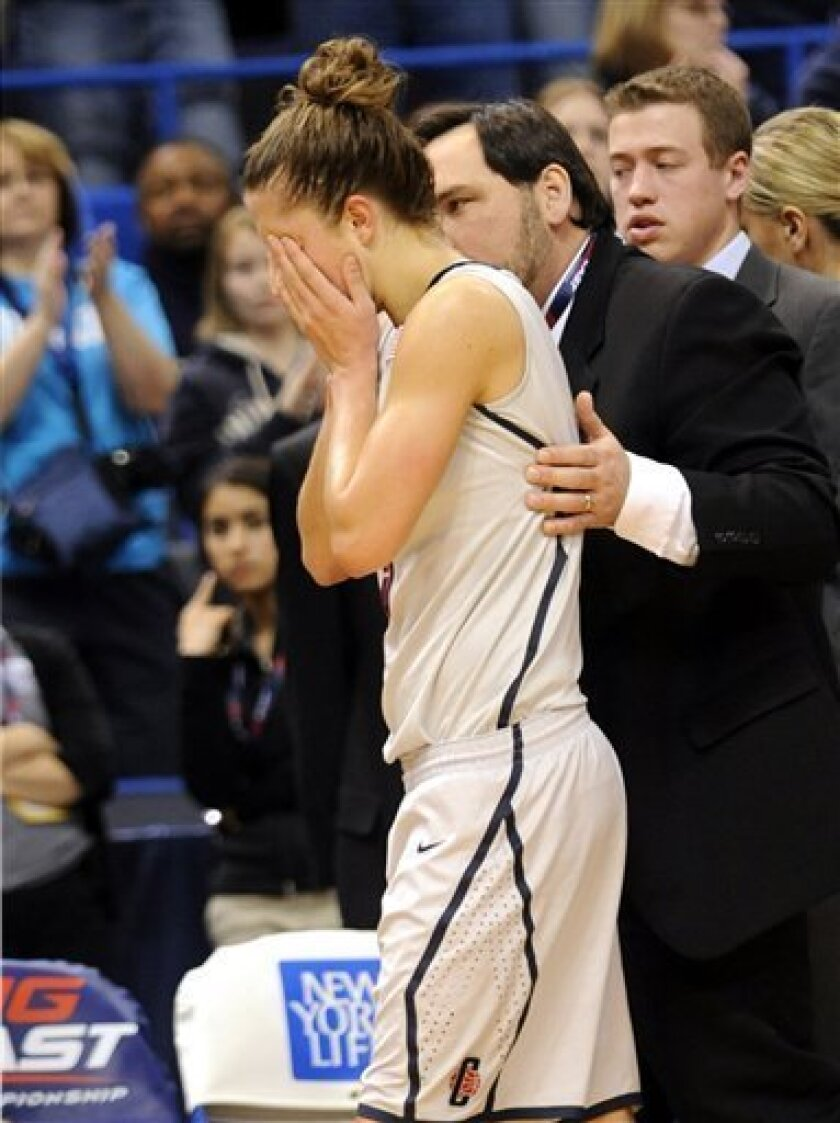 Connecticut's Caroline Doty is helped off the floor after she took an elbow to the head during the second half against Notre Dame in an NCAA college basketball game in the semifinals of the Big East tournament in Hartford, Conn., Monday, March 8, 2010. Connecticut won 59-44. (AP Photo/Bob Child)