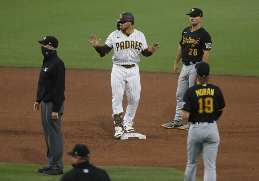 Trent Grisham stands on second base after driving a pinch-hit double