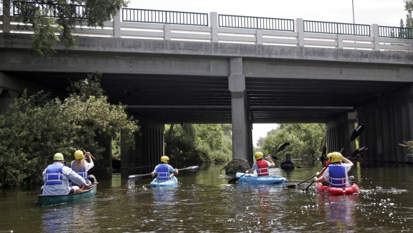 Kayakers paddle down the Los Angeles River in the Sepulveda Dam recreation area in Van Nuys.