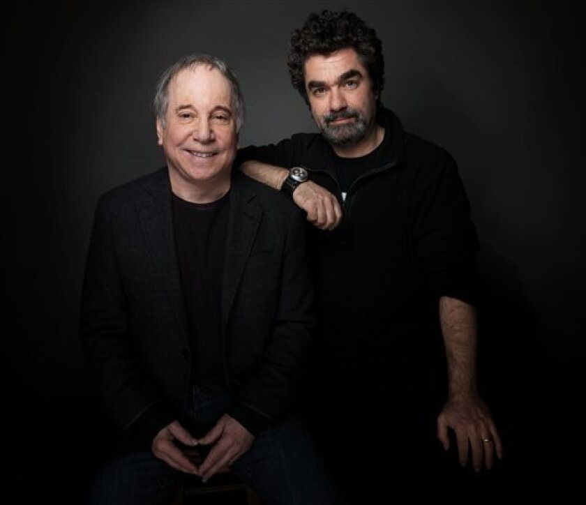 """Singer Paul Simon, left, and director Joe Berlinger, from the film """"Under African Skies,"""" pose for a portrait during the 2012 Sundance Film Festival on Monday, Jan. 23, 2012 in Park City, Utah. (AP Photo/Victoria Will)"""