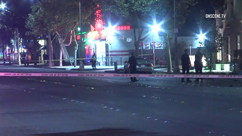 Authorities investigate the Pomona location where police say a man in a wheelchair was killed by a hit-and-run driver Sept. 18.