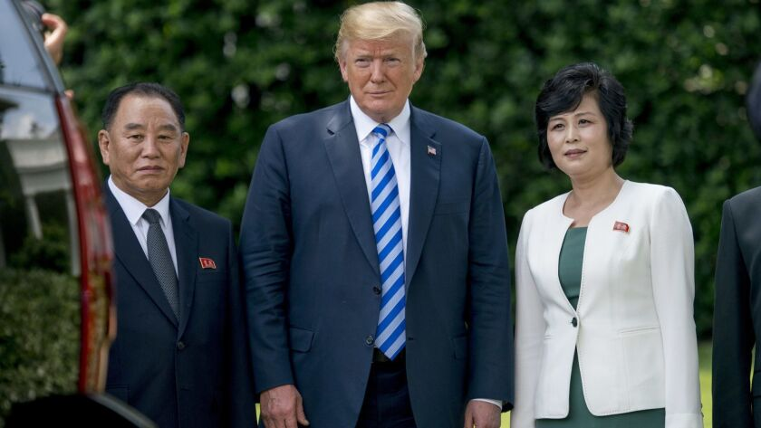 President Trump at the White House on June 1 with former North Korean military intelligence chief Kim Yong Chol, left, and Kim Song Hye, head of North Korea's Committee for the Peaceful Reunification of Korea.