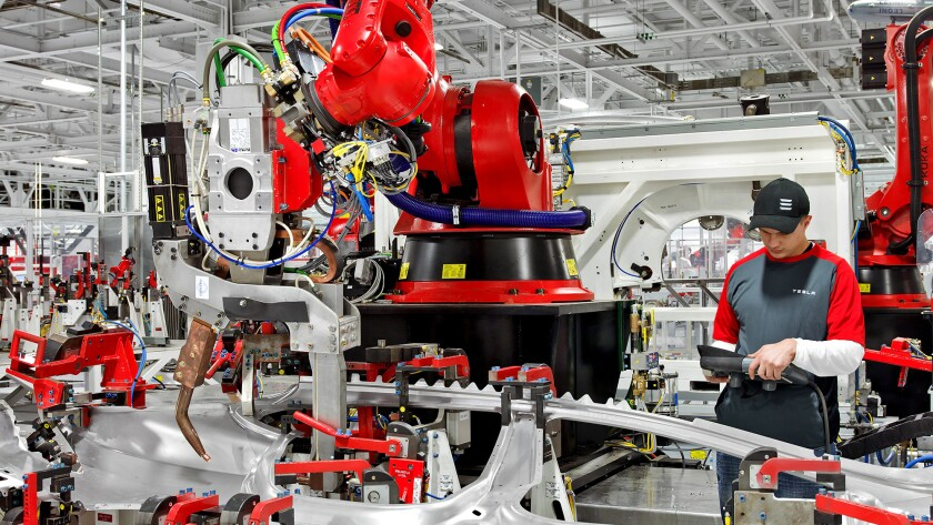 Vehicle assembly at the Tesla production facility in Fremont, Calif.