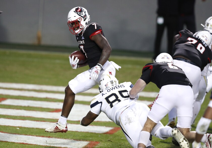 North Carolina State running back Zonovan 'Bam' Knight (7) scores on a 5-yard touchdown run against Georgia Tech during the first half of an NCAA college football game in Raleigh, N.C., Saturday, Dec. 5, 2020. (Ethan Hyman/The News & Observer via AP, Pool)