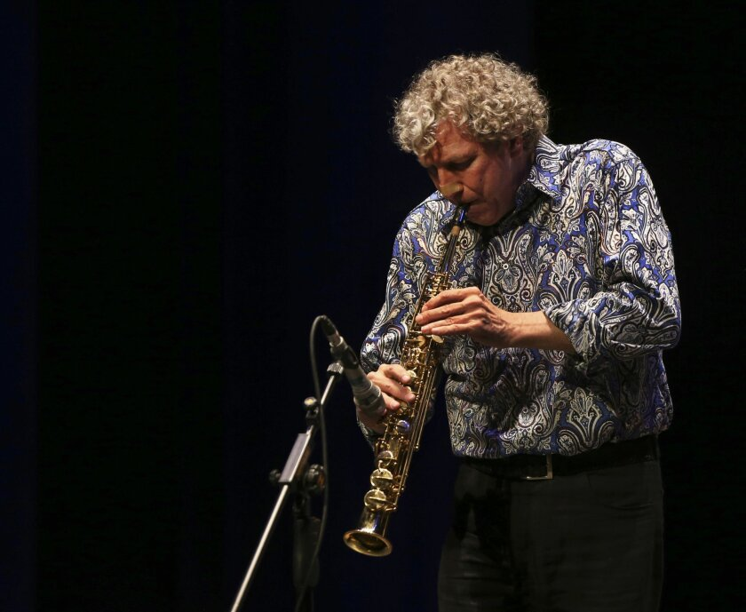FILE - In this Thursday, Feb. 19, 2015, file photo, jazz musician, composer and producer Bob Belden plays soprano saxophone in a performance of the Animation ensemble from the U.S. during the Iranian Fajr International Music Festival at the Vahdat hall in Tehran, Iran. Belden, who was the first American musician to perform in Iran since the 1979 revolution, has died in New York City. He was 58. His sister, Elizabeth Belden Harmstone, said the saxophonist died Wednesday, May 2015, at Lenox Hill Hospital in Manhattan after suffering a heart attack. (AP Photo/Vahid Salemi, File)