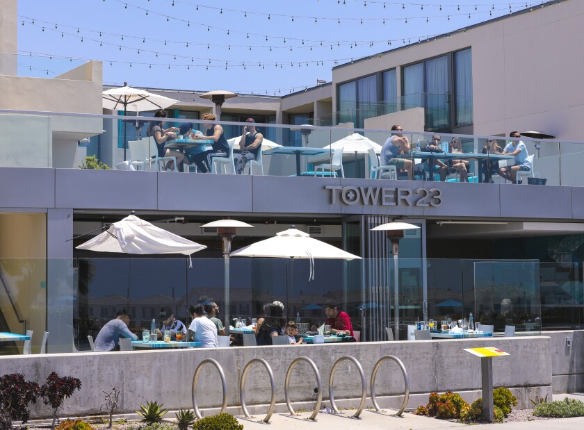 Local restaurants in Pacific Beach were open for dining-in and appeared to have customer tables spaced out for social distancing. Officials and local business owners report the traditional holiday weekend beach crowd is down from years past.