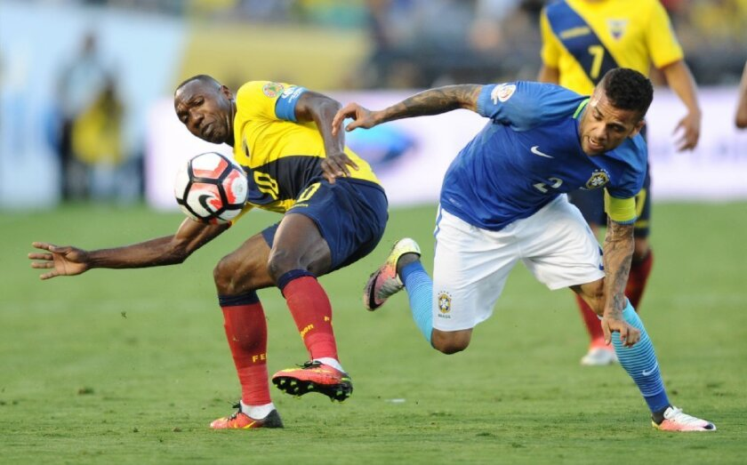 Ecuador's Walter Ayom battles Brazil's Dani Alves for the ball in the first half of a Copa America Centenario match at the Rose Bowl on June 4.