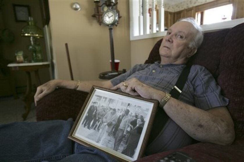 """FILE - In this Wednesday, March 4, 2009, file photo, Elwin Hope Wilson holds a framed photo he kept showing a mob he participated in during one of local civil rights """"sit-ins"""" that took place in the early 1960s, in Rock Hill, S.C.  The South Carolina man who publicly apologized for years of violent"""