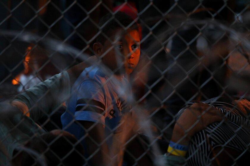IMG_la-na-asylum-migrant_2_1_1J5P7RNF_L217697546.JPG