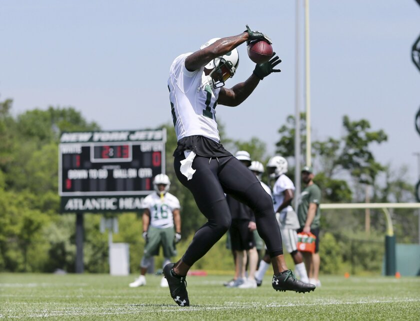 New York Jets wide receiver Brandon Marshall tries to keep his feet inbounds as he catches a pass during NFL football practice Wednesday, June 1, 2016, in Florham Park, N.J. (AP Photo/Mel Evans)