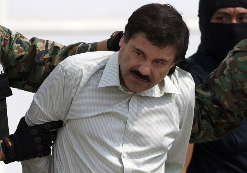 """Joaquin """"El Chapo"""" Guzman is escorted to a helicopter in handcuffs by Mexican navy marines at a navy hanger in Mexico City, Saturday, Feb. 22, 2014. A senior U.S. law enforcement official said Saturday, that Guzman, the head of Mexicoís Sinaloa Cartel, was captured alive overnight in the beach reso"""