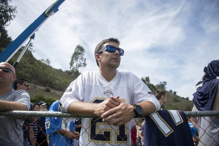 """Sean Farrell watches the Chargers practice during the second day of training camp on July 31, 2015 at  Chargers Park. Farrell runs a popular Facebook page called """"You Know Your A Chargers Fan When"""" and is an outspoken advocate for saving the Chargers.  ."""
