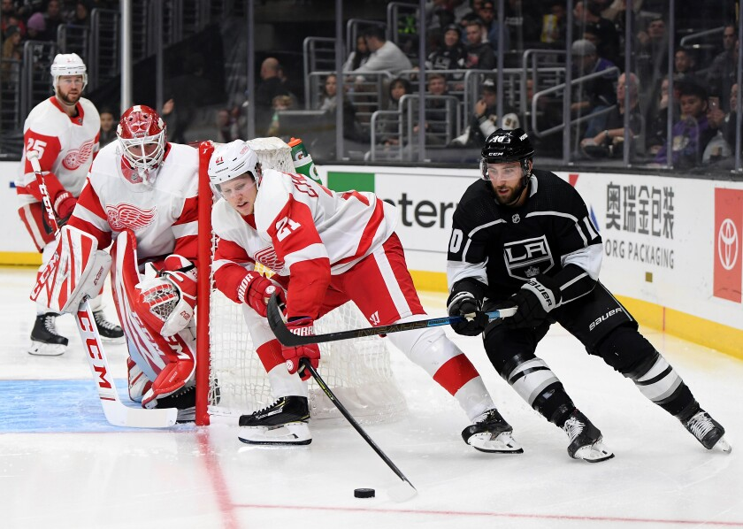 Kings center Michael Amadio (10) eyes the puck in front a pack of Red Wings during a game Nov. 14 at Staples Center.